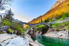 Two arches stone bridge Ponte dei Salti. Two arches stone bridge soars over turquoise water stream of Valle Verzasca named Ponte dei Salti in canton of Ticino stock image