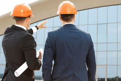 Two architect assessing their building progress. Outdoors Stock Photo