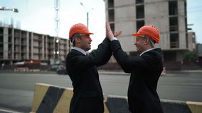 Two architect customers funny high five stock footage