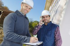Two architect partners taking break on building site Stock Photography
