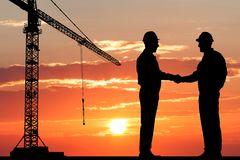 Two architect shaking hand royalty free stock photo