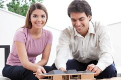 Two Architects Building a House Model royalty free stock photos