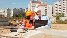 Two architects  in front of building site Stock Image