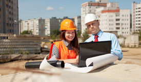 Two architects in front of building site Royalty Free Stock Photo