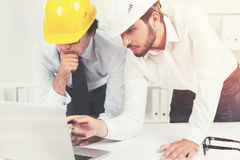 Two architects in hardhats in an office Stock Photo
