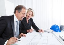 Two architects looking at plans Royalty Free Stock Photo