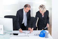 Two Architects Looking At Plans Stock Photos