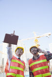 Two architects looking and pointing at construction site Royalty Free Stock Images