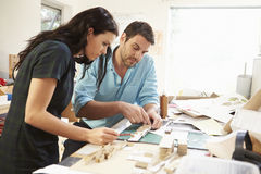 Two Architects Making Models In Office Together Royalty Free Stock Image