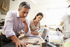 Two Architects Making Models In Office Using Digital Tablet royalty free stock images