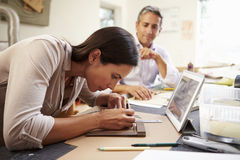 Two Architects Making Models In Office Using Digital Tablet Royalty Free Stock Photography
