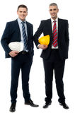 Two architects posing with safety helmet Stock Images