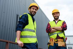 two architects in safety vests and hardhats standing royalty free stock photos