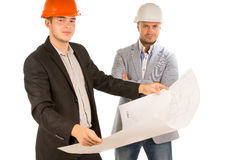 Two architects studying a building blueprint Royalty Free Stock Photos