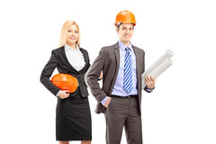 Two architects in suit holding blueprints Royalty Free Stock Photo