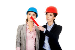 Two architects women discussing. Royalty Free Stock Photos