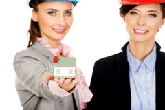 Two architects women with house model. Stock Images