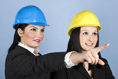 Two architects women pointing royalty free stock images