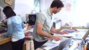 Two Architects Working On Models In Office Together stock footage