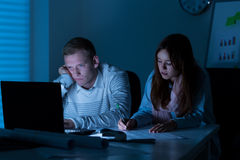 Two architects working at night Stock Image