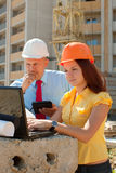 Two architects works in front of building site Royalty Free Stock Photos