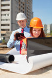 Two architects works in front of building site Royalty Free Stock Photography
