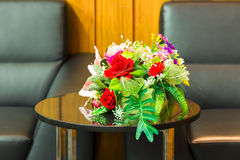 Two arm chairs leather and marble table, and bouquet of red rose Royalty Free Stock Photo