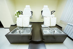 Two armchairs and bathtubs in pedicure cabinet Stock Photo
