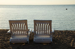 Two armchairs at beach Royalty Free Stock Image