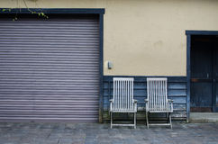 Two armchairs and wall Stock Photography