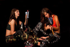 Two armed girls. Image of a two armed paintball players preparing to the game Royalty Free Stock Images