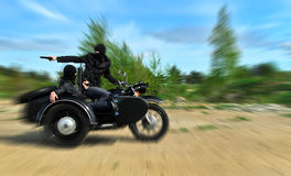 Two armed men riding a motorcycle. With a sidecar. Motion blur Royalty Free Stock Image