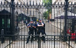 Two armed police at ten downing street royalty free stock photos