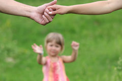 Two arms of lovers and young daughter Royalty Free Stock Images