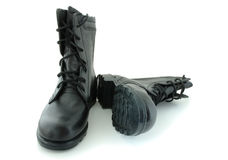 Two army boots. Black leather army boots on overwhite background royalty free stock images