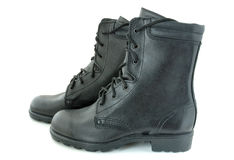 Two army boots. Black leather army boots on overwhite background stock image