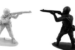 Two army men pointing guns at each other Stock Photos