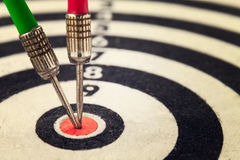Two arrow dart hit the center of the target dartboard Stock Photography