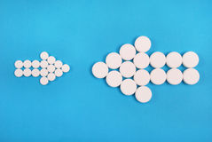 Two arrows collected of tablets Royalty Free Stock Image
