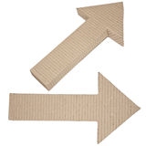 Two arrows made of corrugated cardboard Stock Photos