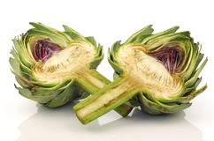 two artichoke halves with a stem Royalty Free Stock Images