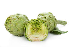 Two artichokes and a half Stock Photos