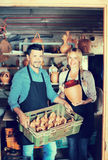 Two artisans having ceramics. Two cheerful potters having ceramics in hands and standing in workshop royalty free stock images