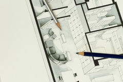 Two artistic drawing pencils set on actual real estate floor plan architectural isometric drawing Stock Images