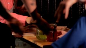 Two artistic girls play backgammon in a restaurant.  stock footage