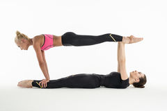 Two artistic gymnast doing paired exercises Royalty Free Stock Photography