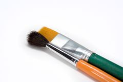 Two artistic paint brushes on white background Royalty Free Stock Images