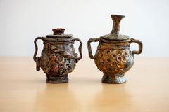 Two artwork and handmade ceramic pots like antique amphora. Two artwork handmade small ceramic pots like old ancient ampfora stock image