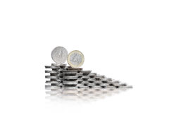 Two ascending group of piles of coins with quarter dollar and on Royalty Free Stock Image