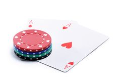 Two ases and casino chips Stock Photo